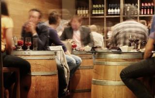 International wine fair VINISTRA - people drinking wine in a bar