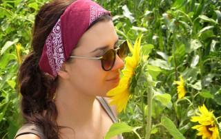 pesticide free flowers - woman sniffs sunflower